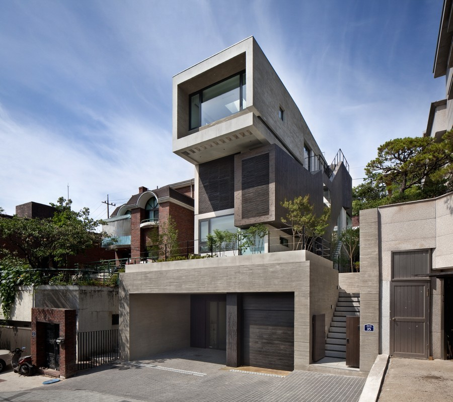 Ridged ribbons of concrete wrap house in South Korea by ODE Architects