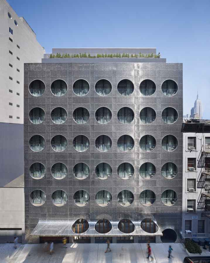 A Boutique New York City Hotel with an Emphasis on Service and After-Dark Possibilities Fronted by an ocean liner-inspired stainless steel façade and riddled with porthole windows, the grand exterior of Dream Downtown hails its s role as the National Maritime Union headquarters.