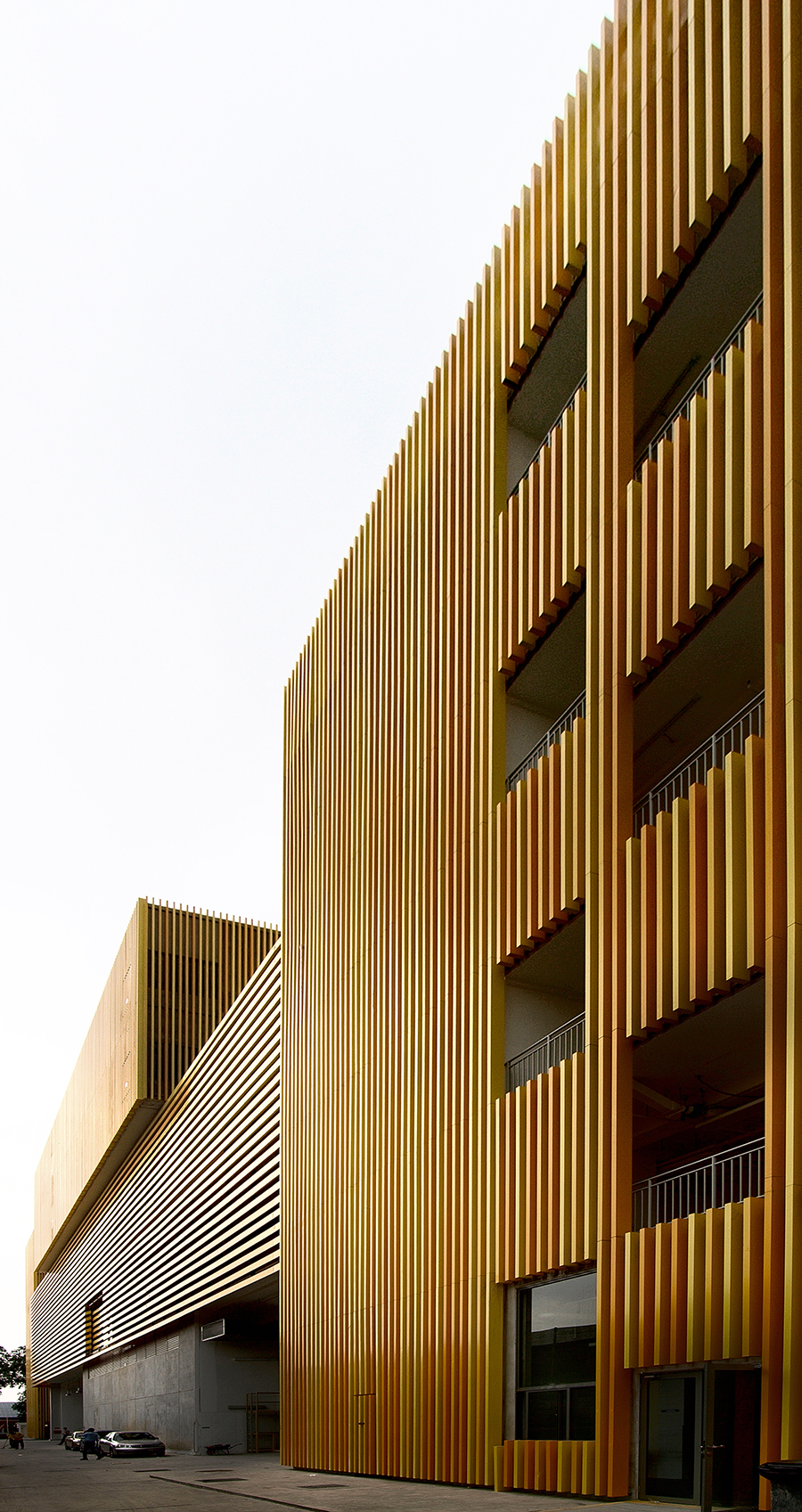 The building's stacked timber box design is a series of interconnected volumes which correspond to their interior functions