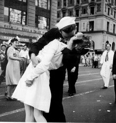 """New York City celebrating the surrender of Japan. They threw anything and kissed anybody in Times Square."". Photo by Lt. Victor Jorgensen, 14 August 1945, courtesy of Wikipedia: ""This is a work of a sailor or employee of the U.S. Navy, taken or made as part of that person's official duties. As a work of the U.S. federal government, the image is in the public domain."""