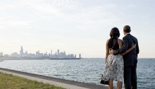 """President Barack Obama and First Lady Michelle Obama look out at the city skyline and Lake Michigan after arriving at the Burnham Park landing zone in Chicago, Illinois, June 15, 2012. (Official White House Photo by Pete Souza) June 15, 2012 """"We had just arrived at the helicopter landing zone in Chicago and instead of walking right to the motorcade, the President and First Lady walked past their vehicle to the edge of Lake Michigan to view the skyline of their home town."""" (Official White House Photo by Pete Souza)"""