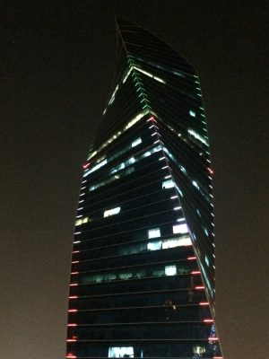 Kuwait twisting skyscraper at night with coloured lighting