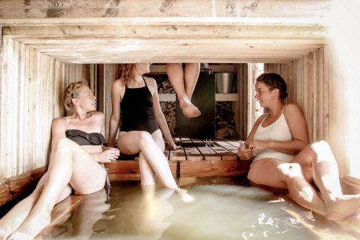 Floating wilderness sauna bathing students in Soomaa