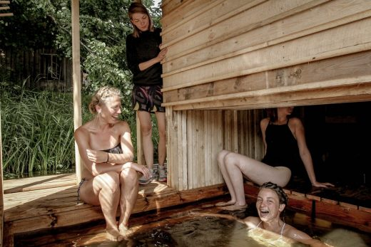 Floating wilderness sauna female bathing students in Soomaa