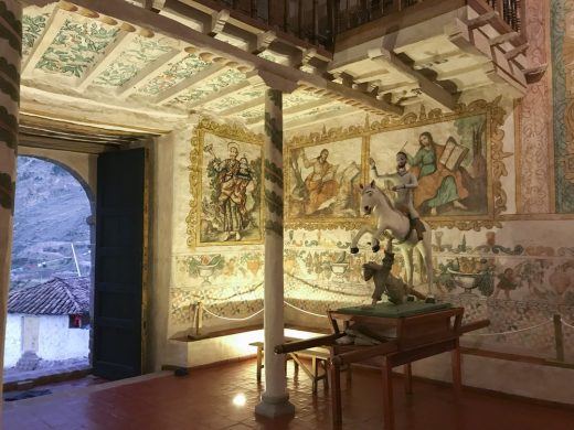 Interior view of the wall paintings and statue of Saint Santiago, patron saint of the church of Kuñotambo