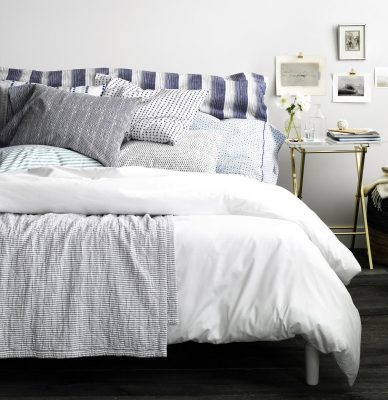 add pillows to make Your Bedroom Look More Luxurious