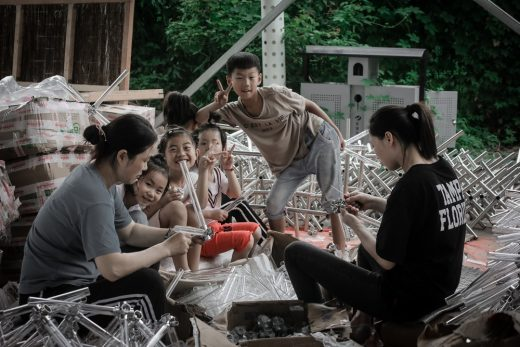 Local children join the construction work China