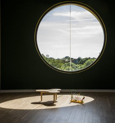 Vinh nursery interior circular window