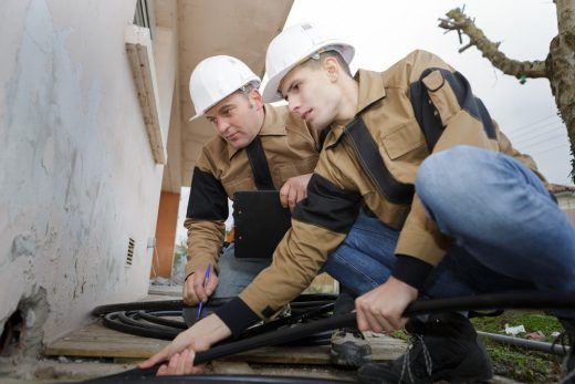 plumbers working outdoors