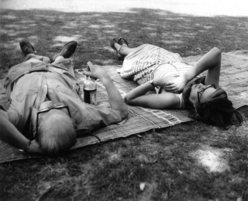 Le Corbusier and Jane Drew lying on a rug